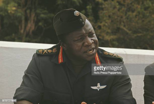 President of Uganda Idi Amin pictured attending a lunch with British High Commissioner Richard Slater the Indian High Commissioner Pakistan's...