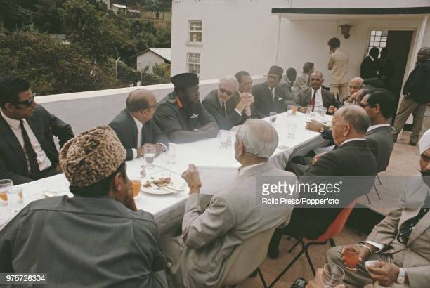 President of Uganda Idi Amin pictured with British High Commissioner Richard Slater the Indian High Commissioner Pakistan's Ambassador and leaders of...