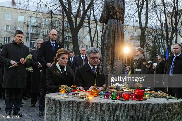 President of Ukraine Petro Poroshenko with his wife Maryna Poroshenko honor the memory of Holodomor victims laying the bouquets from ears and...