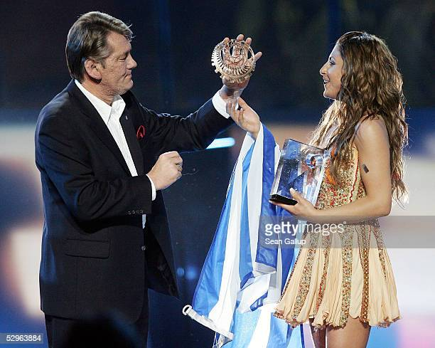 President of Ukraine Viktor Yushchenko presents a special prize to singer Helena Paparizou of Greece after she won the first prize at the Eurovision...