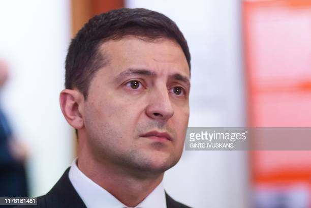 President of Ukraine Volodymyr Zelensky visits an exposition at the Latvian Museum of Occupation in Riga Latvia on October 16 2019 Ukraine President...