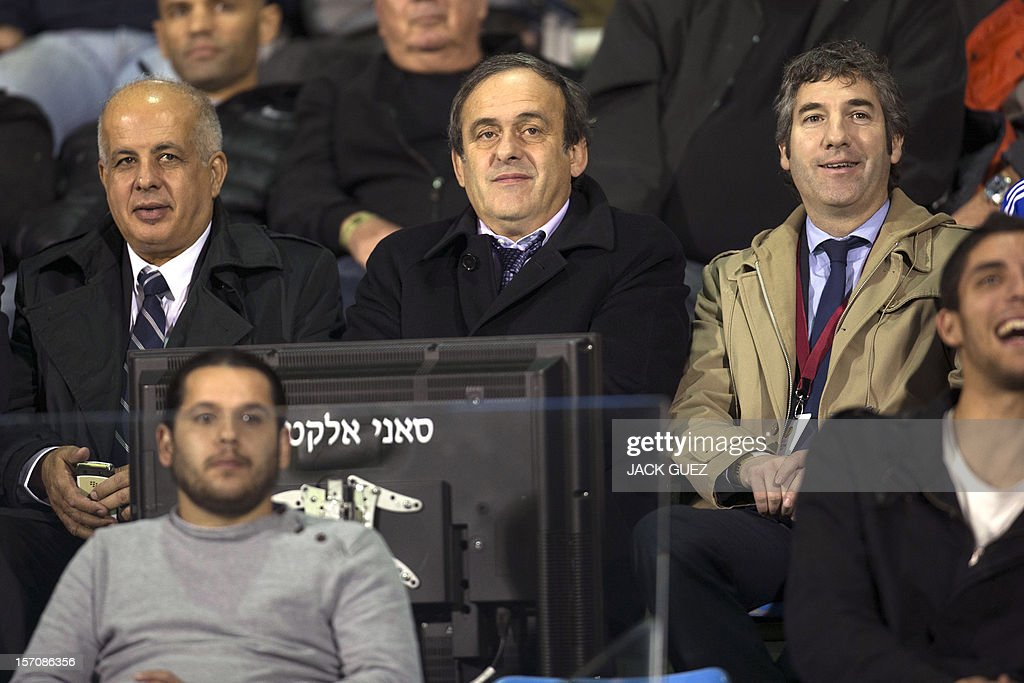 President of Union of European Football Associations (UEFA) Michel Platini (C) and president of the Israel Football Association (IFA) Avraham Luzon (L) attend the UEFA Europa League Group I qualifying football match between Israel's Hapoel Kiryat Shmona and Spain's Athletic Club at the Kiryat Eliezer Stadium, in the Mediterranean coastal city of Haifa, on November 28, 2012.