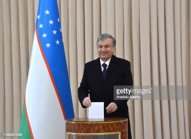 President of Uzbekistan Shavkat Mirziyoyev casts his vote at a polling station during general elections in Tashkent, Uzbekistan on December 22, 2019....