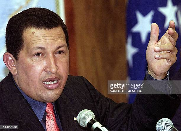 President of Venezuela Hugo Chavez answers questions during a press conference 03 April 2001 in Brasilia Brazil Chavez told reporters he had...