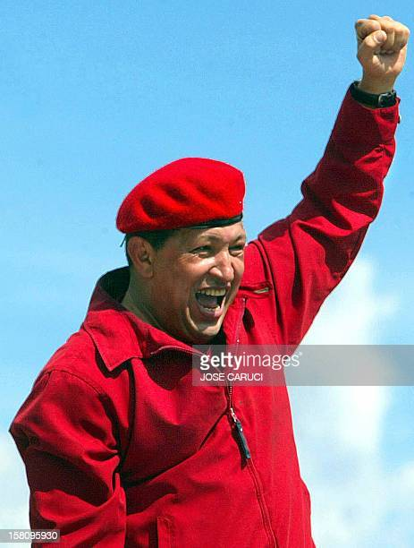 President of Venezuela Hugo Chávez greets supporters during the march for peace and democracy in Caracas 13 October 2002 Tens of thousands of...