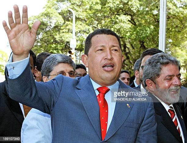 President of Venezuela Hugo Chávez greets the crowd and his Brazilian counterpart Luiz Inacio Lula da Silva 25 April 2003 in Recife Chávez is on an...