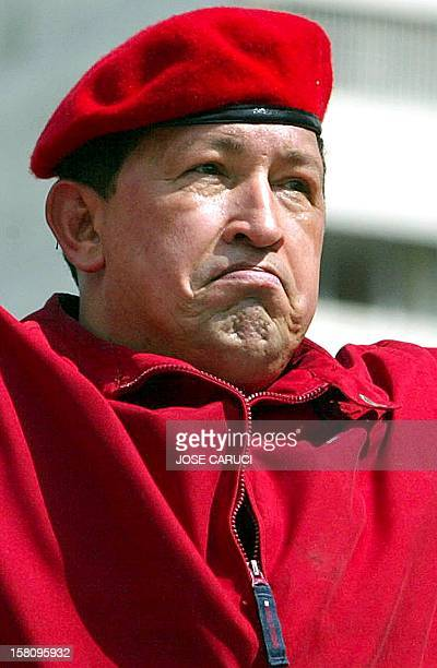 President of Venezuela Hugo Chávez watches supporters during the 'march for peace and democracy' in Caracas 13 October 2002 Tens of thousands of...