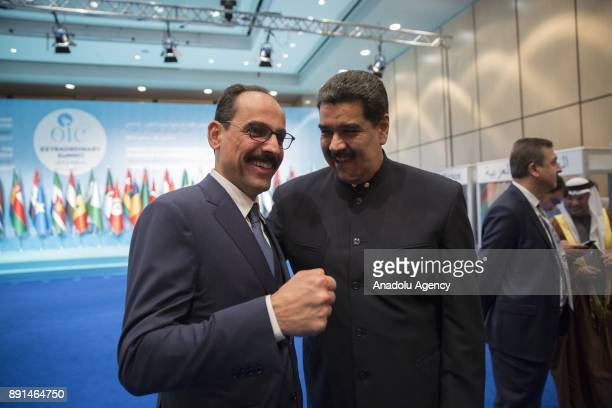 President of Venezuela Nicolas Maduro and Turkish Presidential Spokesman Ibrahim Kalin gesture during the extraordinary summit of the Organisation of...