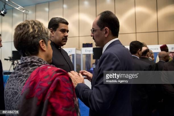 President of Venezuela Nicolas Maduro chats with Turkish Presidential Spokesman Ibrahim Kalin during the extraordinary summit of the Organisation of...