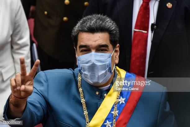 President of Venezuela Nicolas Maduro makes the victory sign as he arrives to give the State of The Nation Report 'Memoria y Cuenta 2020' at Palacio...