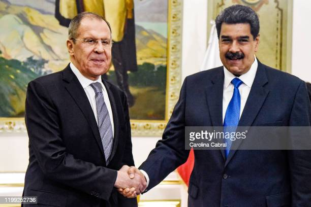 President of Venezuela Nicolas Maduro shakes hands with Minister of Foreign Affairs of the Russian Federation Serguéi Lavrov at Miraflores Government...