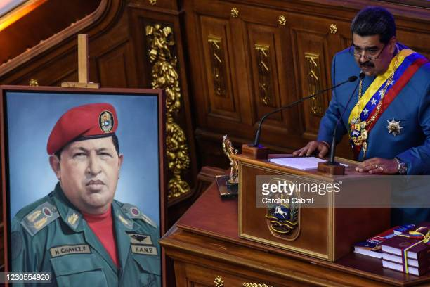 President of Venezuela Nicolas Maduro speaks next to an image of late former President of Venezuela Hugo Chavez during the State of The Nation Report...