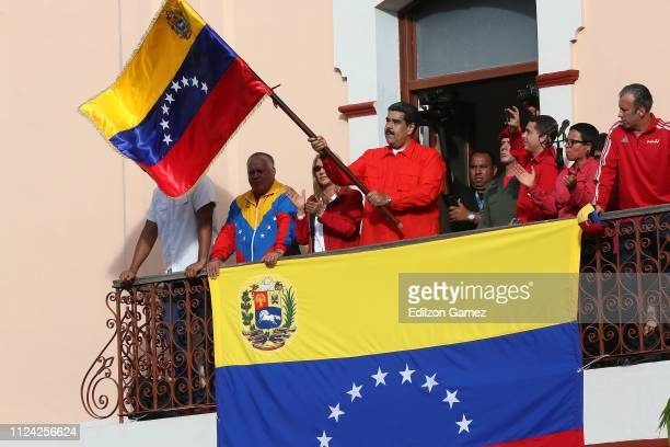 President of Venezuela Nicolás Maduro waves a national flag as he is escorted by Hector Rodriguez Governor of Miranda Diosdado Cabello President of...
