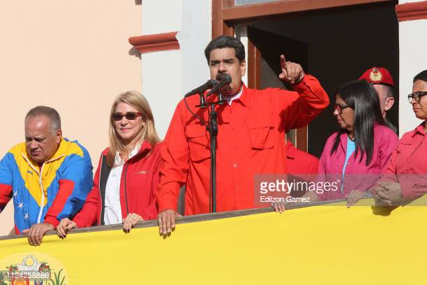 President of Venezuela Nicolás Maduro waves a national flag as he is escorted by Diosdado Cabello President of National Constitutional Assembly Cilia...