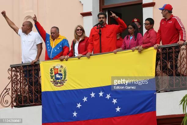 President of Venezuela Nicolás Maduro waves a national flag as he is escorted by Hector Rodriguez, Governor of Miranda; Diosdado Cabello, President...