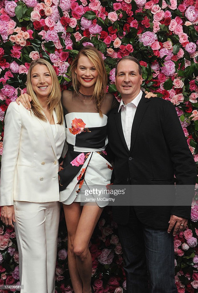 President of Victoria's Secret Beauty, Susie Coulter, Victoria's Secret Angel Behati Prinsloo and VP of Victoria's Secret Fragrance, Mark Knitowski pose together at the Victoria by Victoria's Secret Fragrance launch event at 620 Loft & Garden on July 18, 2013 in New York City.