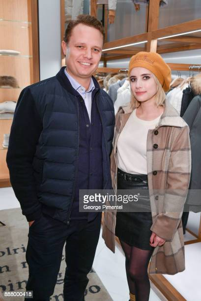 President of Woolrich Nick Brayton and Emma Roberts attend Woolrich Yorkdale Grand Opening at Yorkdale Shopping Center on December 7 2017 in Toronto...