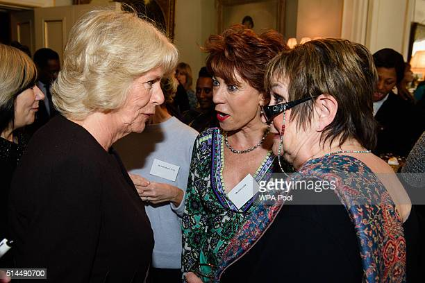 President of WOW Camilla Duchess of Cornwall speaks withspeaks with the author Kathy Lette and British journalist Jenni Murray at a reception for the...