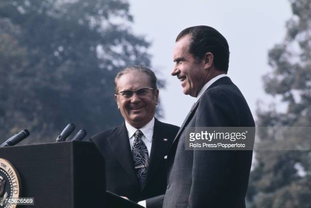 President of Yugoslavia Josip Broz Tito pictured on left with President of the United States Richard Nixon at a press conference in front of The...
