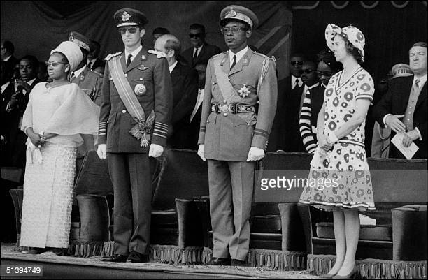 President of Zaire General JosephDTsirT Mobutu Sese Seko KIng Baudouin of Belgium Queen Fabiola and Mobutu's wife review troops 30 June 1970 in...