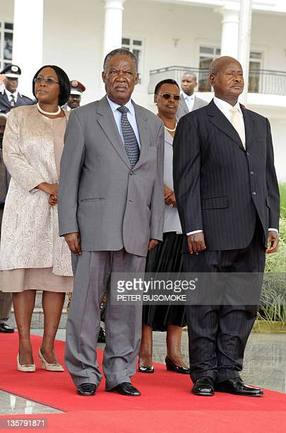 President of Zambia Michael Chilufya Sata with his wife and president of Uganda Yoweri Museveni and wife Janet Museveni pose at State house Entebbe...