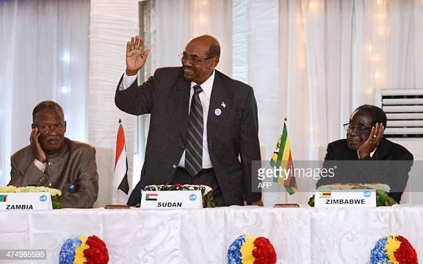 President of Zambia Michael Sata Sudanese President Omar Bashir and Zimbabwe President Robert Mugabe take part in a heads of state meeting of the...