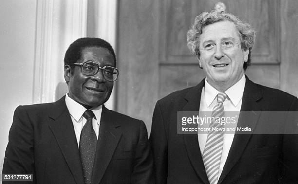 President of Zimbabwe Robert Mugabe with former Taoiseach of Ireland Garrett Fitzgerald at a State reception at Dublin Castle during Mugabe's...