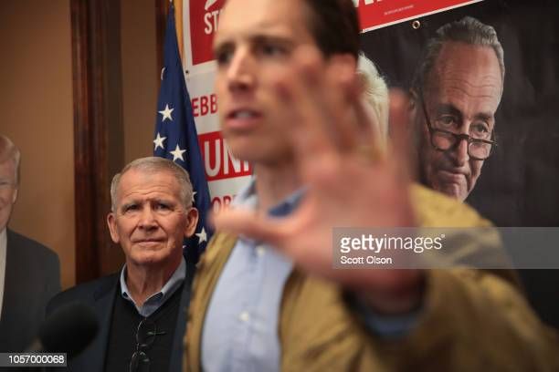 President Oliver North listens as Republican US Senate candidate Josh Hawley speaks to supporters during a campaign stop at the Jefferson County GOP...