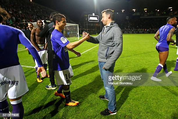 President Olivier Sadran of Toulouse congratulates Wissam Ben Yedder after the football french Ligue 1 match between Angers SCO and Toulouse FC on...