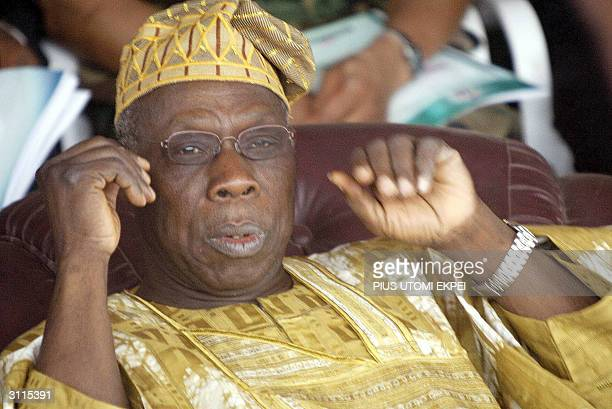 President Olusegun Obasanjo stares at the biggest fish caught at the Argungu fishing festival 20 March 2004 at Argungu in Kebbi State of northern...