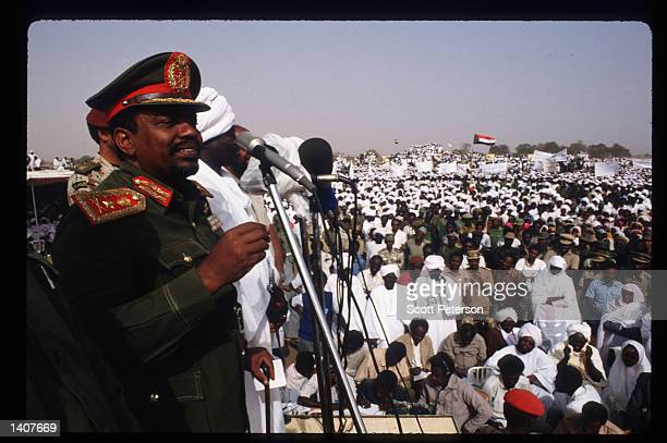 President Omar Hassan elBashir speaks as Sudanese warriors participate in a rally for him February 28 1992 in Ed Daein Sudan Upon his return from a...