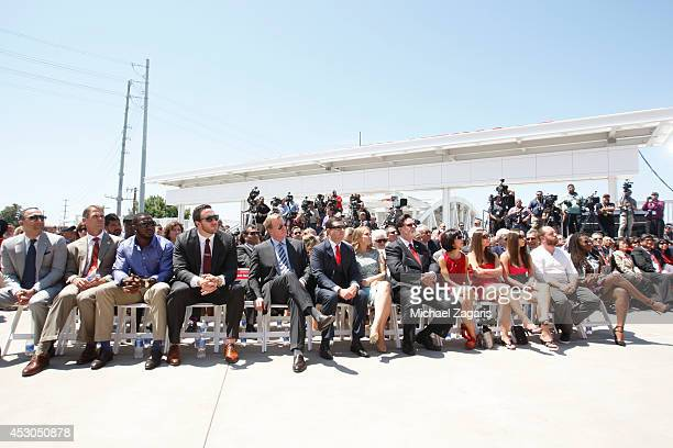 President Paraag Marathe General Manager Trent Baalk Patrick Willis and Joe Staley of the San Francisco 49ers sit in the crowd with NFL Commissioner...