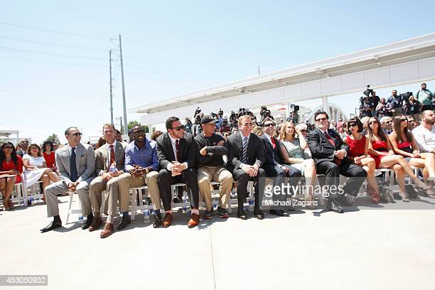 President Paraag Marathe General Manager Trent Baalk Patrick Willis Joe Staley and Head Coach Jim Harbaugh of the San Francisco 49ers sit in the...