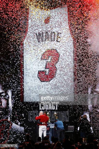 President Pat Riley of the Miami Heat hugs former player Dwyane Wade after revealing his retired jersey banner during the Miami Heat Dwyane Wade...