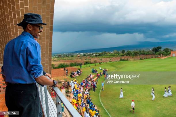 President Paul Kagame reacts as he visits the Gahanga Cricket Oval during the official inauguration on October 28 in Kicukiro District in Kigali...