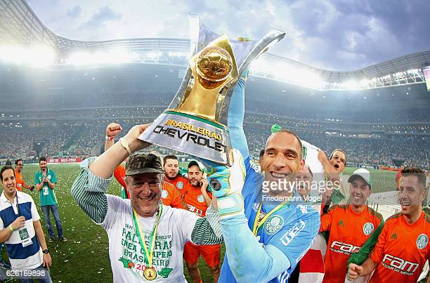 President Paulo Nobre and Fernando Prass of Palmeiras celebrates with the trophy after winning the match between Palmeiras and Chapecoense for the...