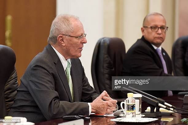 President Pedro Pablo Kuczynski speaks during his meeting with Chinese Premier Li Keqiang at the Great Hall of the People in Beijing on September 14,...