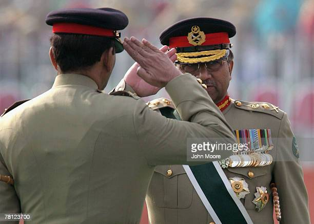 President Pervez Musharraf and new Pakistani army chief Gen Ashfaq Kayani salute after Musharraf passed him a ceremonial baton at a change of command...