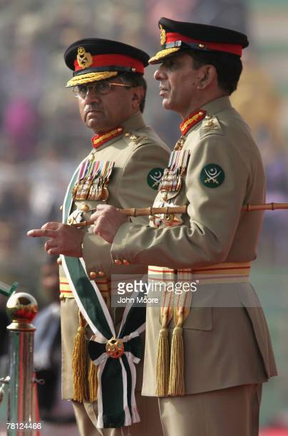 President Pervez Musharraf and the new Pakistani army chief Gen Ashfaq Kayani watch as troops pass by during a change of command ceremony November 28...