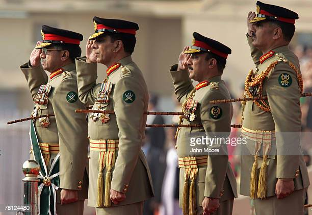 President Pervez Musharraf and the new Pakistani army chief Gen Ashfaq Kayani salute as troops pass by during a change of command ceremony November...