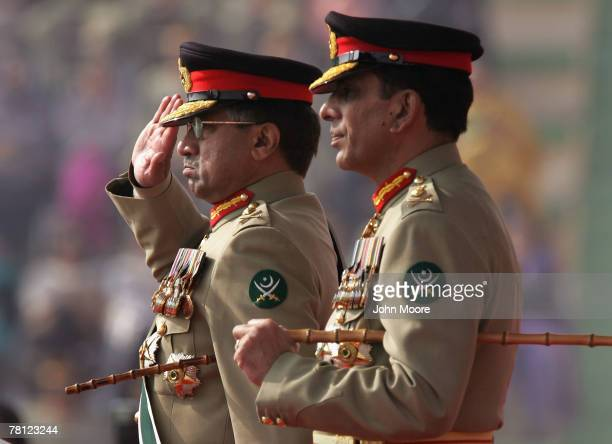 President Pervez Musharraf gives a farewell salute to Pakistani army troops while standing next to new army chief Gen Ashfaq Kayani at a change of...