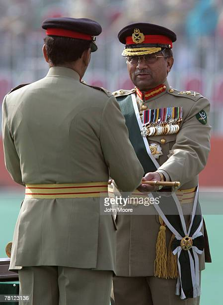President Pervez Musharraf hands over a ceremonial baton to the new army chief Gen Ashfaq Kayani at a change of command ceremony in November 28 2007...