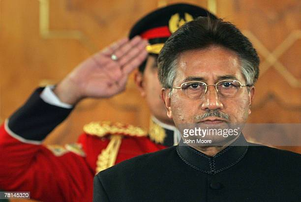 President Pervez Musharraf listens to the national anthem before taking the oath of office for a five-year term as a civilian president November 29,...