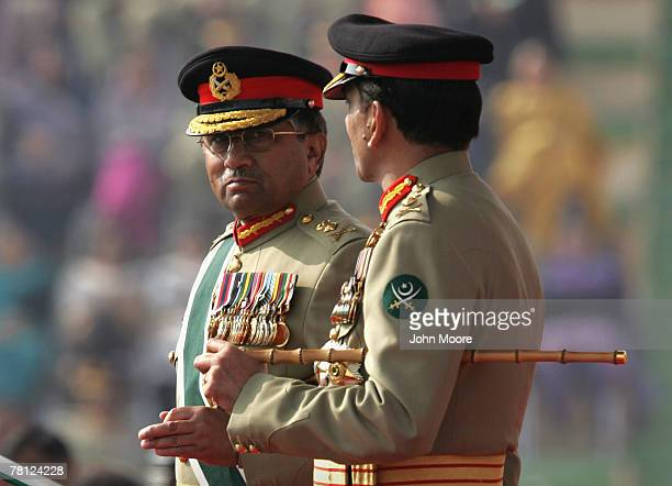 President Pervez Musharraf speaks with the new Pakistani army chief Gen Ashfaq Kayani at a change of command ceremony November 28 2007 in Rawalpindi...