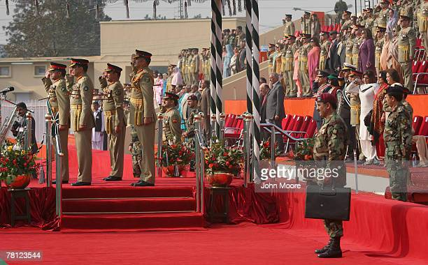 President Pervez Musharraf stands next to the new Pakistani army chief Gen Ashfaq Kayani at a change of command ceremony November 28 2007 in...