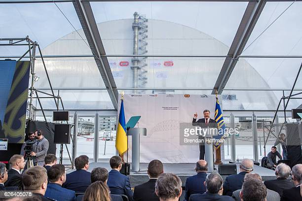 President Petro Poroshenko of Ukraine speaks at a ceremony marking the positioning of the New Safe Confinement sarcophagus over Chernobyl nuclear...
