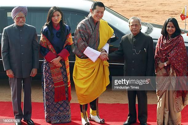 President Pranab Mukherjee greets Bhutan's King Jigme Khesar Namgyel Wangchuck as Prime Minister Manmohan Singh Bhutan's Queen Jetsun Pema and...