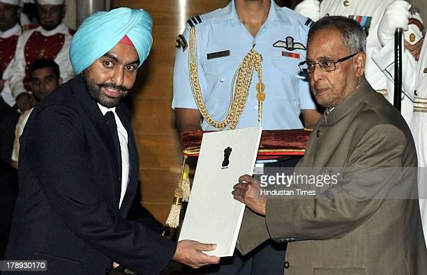 President Pranab Mukherjee honors shooter Ronjan Sodhi with Rajiv Gandhi Khel Ratna during National Sports Award presentation ceremony at Rashtrapati...