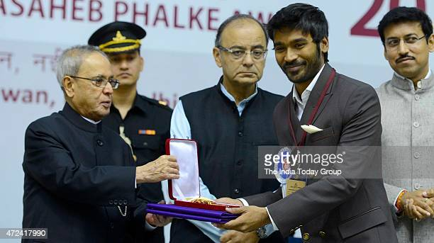 President Pranab Mukherjee persenting 62nd National Film Award to Dhanush at the award ceremony in New Delhi