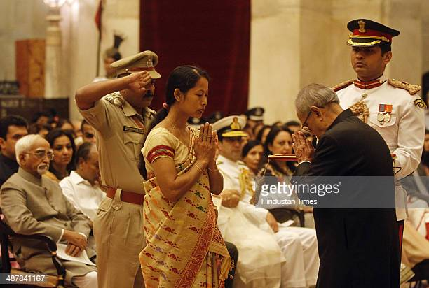 President Pranab Mukherjee presenting Kirti Chakra to Pratibha Sonowal wife of late inspector Lohit Sonowal of Assam during the Defence Investiture...
